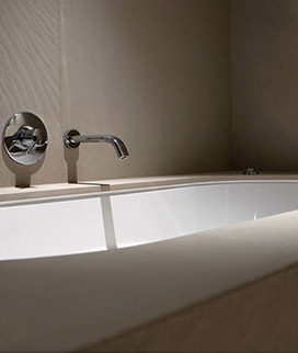 Undermounted bath Surround And wall cladding floor to ceiling